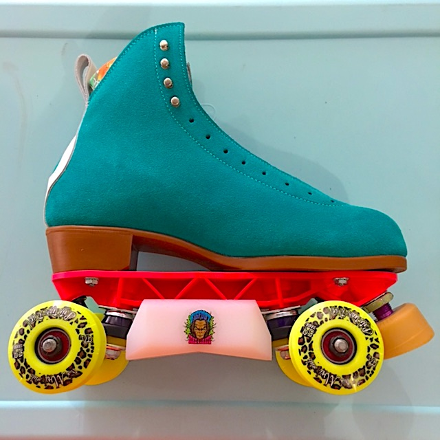 Bigfoot aggressive roller skate plates with slider blocks on MOXI Jack boots.