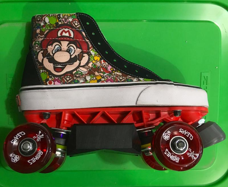 Aggressive sneaker roller skates: Mario brothers Vans.