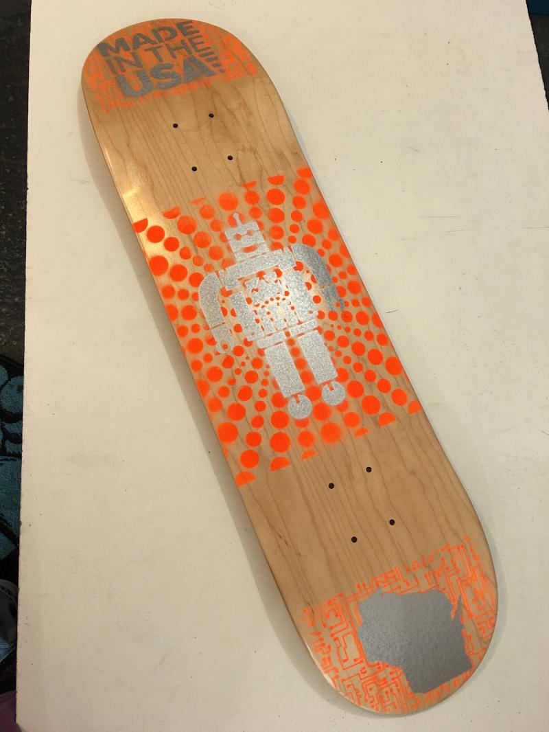 Bigfoot skateboards (orange robot) at Bigfoot Bike and Skate, Milwaukee, WI.